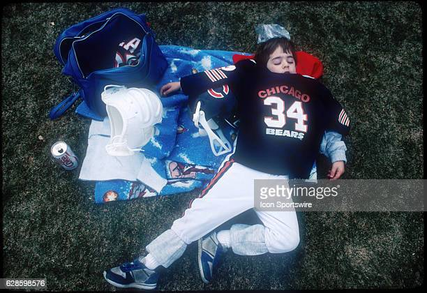 1980's A young fan of Running back Walter Payton of the Chicago Bears sleeps