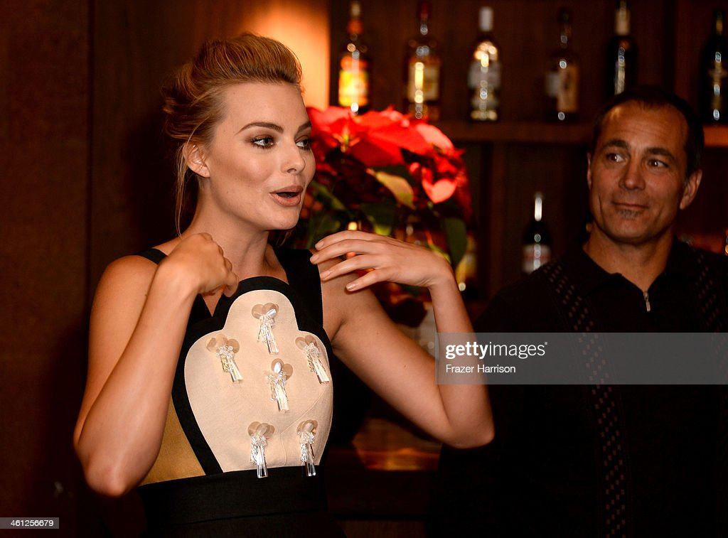 AIF's Actress <a gi-track='captionPersonalityLinkClicked' href=/galleries/search?phrase=Margot+Robbie&family=editorial&specificpeople=5781742 ng-click='$event.stopPropagation()'>Margot Robbie</a> and Aif's Andrew Warne attend an Australians In Film Screening Of 'The Wolf Of Wall Street' at Landmark Theatre on January 7, 2014 in Los Angeles, California.
