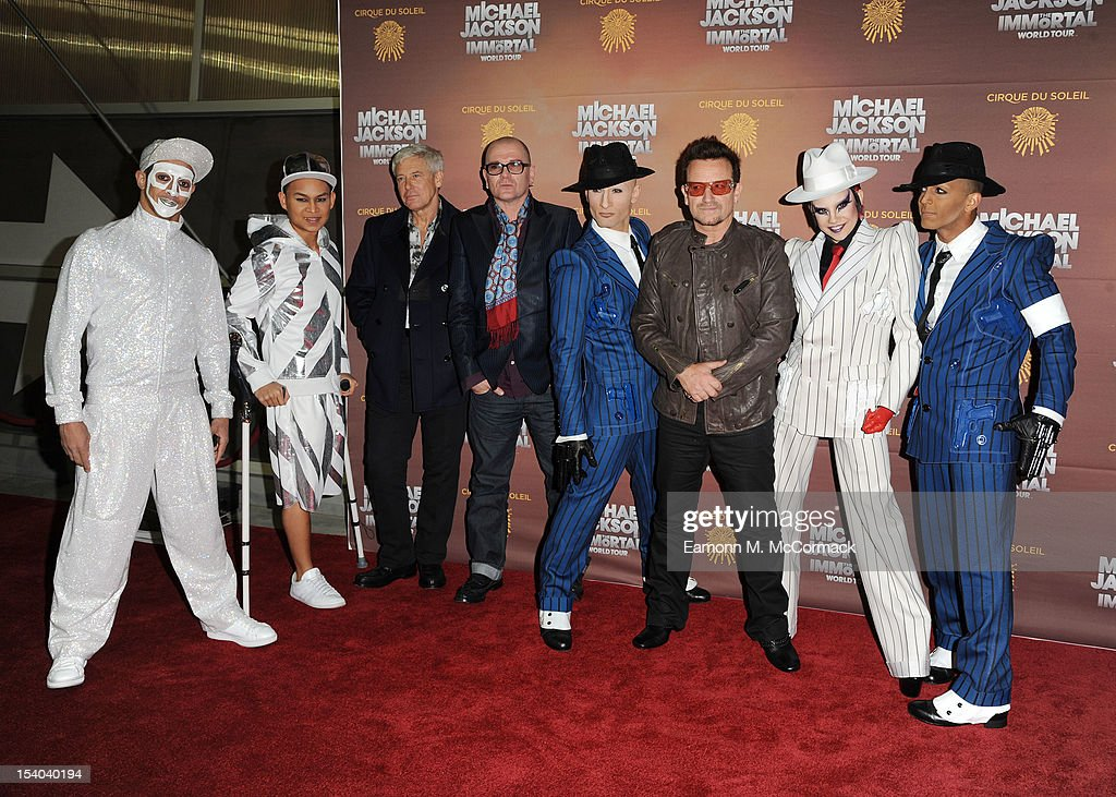 U2's Adam Clayton (L) and <a gi-track='captionPersonalityLinkClicked' href=/galleries/search?phrase=Bono+-+Singer&family=editorial&specificpeople=167279 ng-click='$event.stopPropagation()'>Bono</a> attend the opening night of Cirque Du Soleil's 'Michael Jackson The Immortal World Tour' at 02 Arena on October 12, 2012 in London, England.