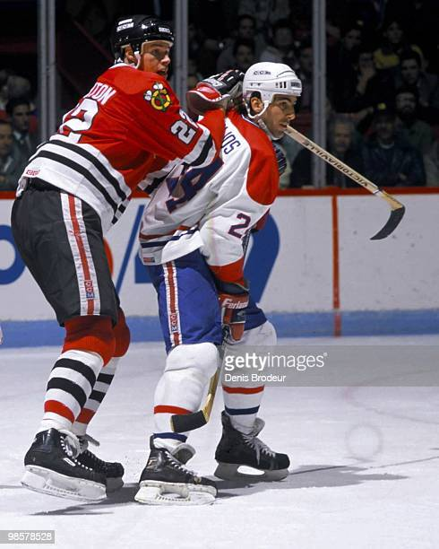 MONTREAL 1980's Adam Creighton of the Chicago Blackhawks skates against Chris Chelios of the Montreal Canadiens in the 1980's at the Montreal Forum...