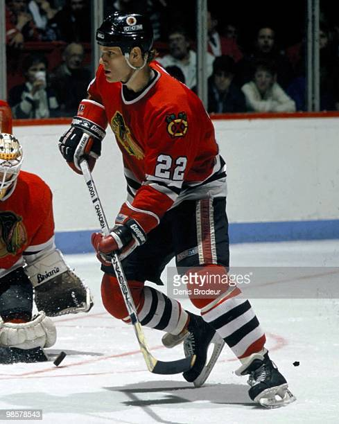 MONTREAL 1980's Adam Creighton of the Chicago Blackhawks skates against the Montreal Canadiens in the 1980's at the Montreal Forum in Montreal Quebec...