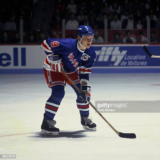 MONTREAL 1990's Adam Graves of the New York Rangers looks for the puck against the Montreal Canadiens in the 1990's at the Montreal Forum in Montreal...