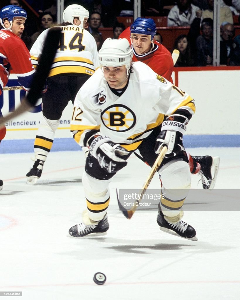 MONTREAL 1990's Adam Oates of the Boston Bruins skates for the puck against the Montreal Canadiens in the early 1990's at the Montreal Forum in...