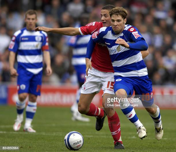 QPR's Akos Buzsaky dribbles past Nottingham Forest's Chris Cohen during the CocaCola Championship match at Loftus Road London