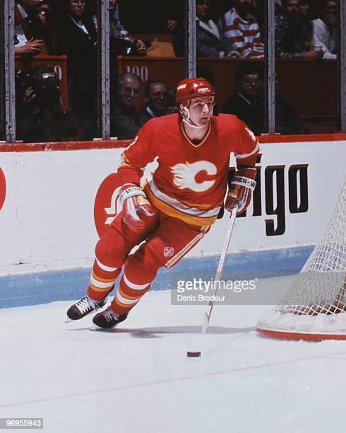 MONTREAL 1980's Al MacInnis of the Calgary Flames carries the puck against the Montreal Canadiens in the late 1980's at the Montreal Forum in...
