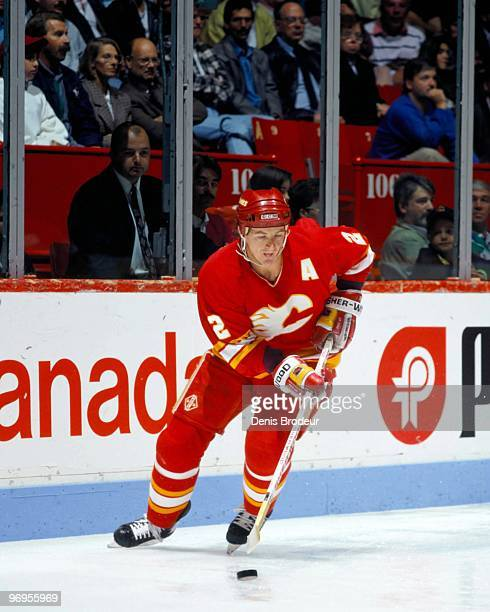 MONTREAL 1980's Al MacInnis of the Calgary Flames skates with the puck against the Montreal Canadiens in the late 1980's at the Montreal Forum in...