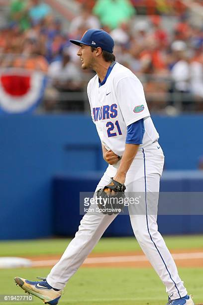 UF's Alex Faedo is psyched after striking out the batter for the third out during the NCAA Super Regional game between the Florida State Seminoles...