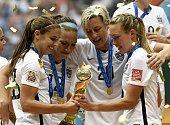 USA's Alex Morgan Lauren Holiday Abby Wambach and Whitney Engen celebrate after winning the final 2015 FIFA Women's World Cup match between USA and...