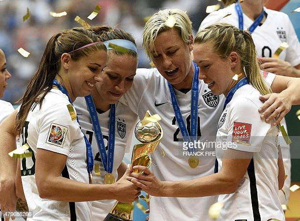 USA's Alex Morgan Lauren Holiday Abby Wambach and Whitney Engen celebrate after winning the final 2015 FIFA Women's World Cup match between USA and...