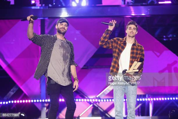DJ's Alex Pall and Drew Taggart of The Chainsmokers accept the 'Woodie of the Year' award onstage at MTV Woodies LIVE on March 16 2017 in Austin Texas