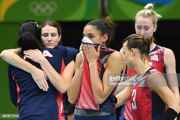 USA's Alisha Glass reacts with teammates after losing their women's semifinal volleyball match against Serbia at the Maracanazinho stadium in Rio de...