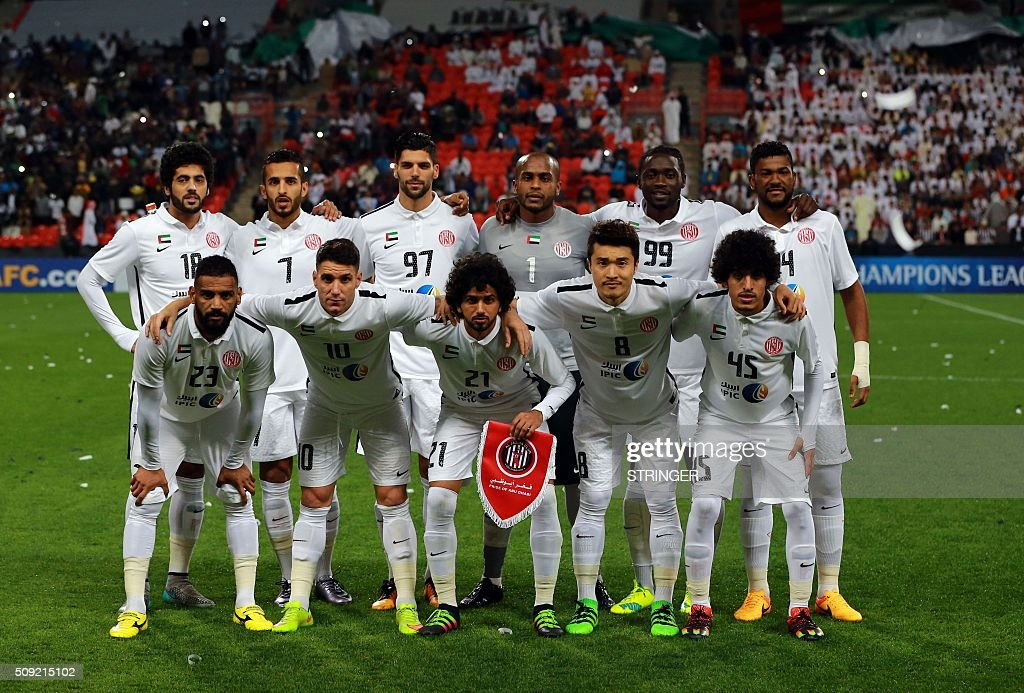 UAE's Al-Jazeera starting eleven pose for a team photo prior to the start of their AFC Champions League third round qualifying football match against Qatar's Al-Sadd club at the Mohammed Bin Zayed Stadium in Abu Dhabi on February 9, 2016. / AFP / STRINGER