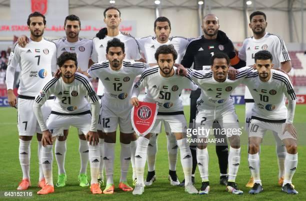 UEA's AlJazira Club players pose for a picture ahead of the Asian Champions League football match between Qatar's Lekhwiya SC and UEA's AlJazira Club...