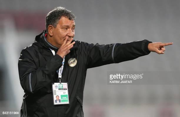 UEA's AlJazira head coach Henk ten Cate of Holland gestures during the Asian Champions League football match between Qatar's Lekhwiya SC and UEA's...