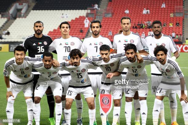 UAE's alJazira's players pose for a group photo ahead of their AFC Champions League Group B match at the Mohammed Bin Zayed Stadium in Abu Dhabi on...