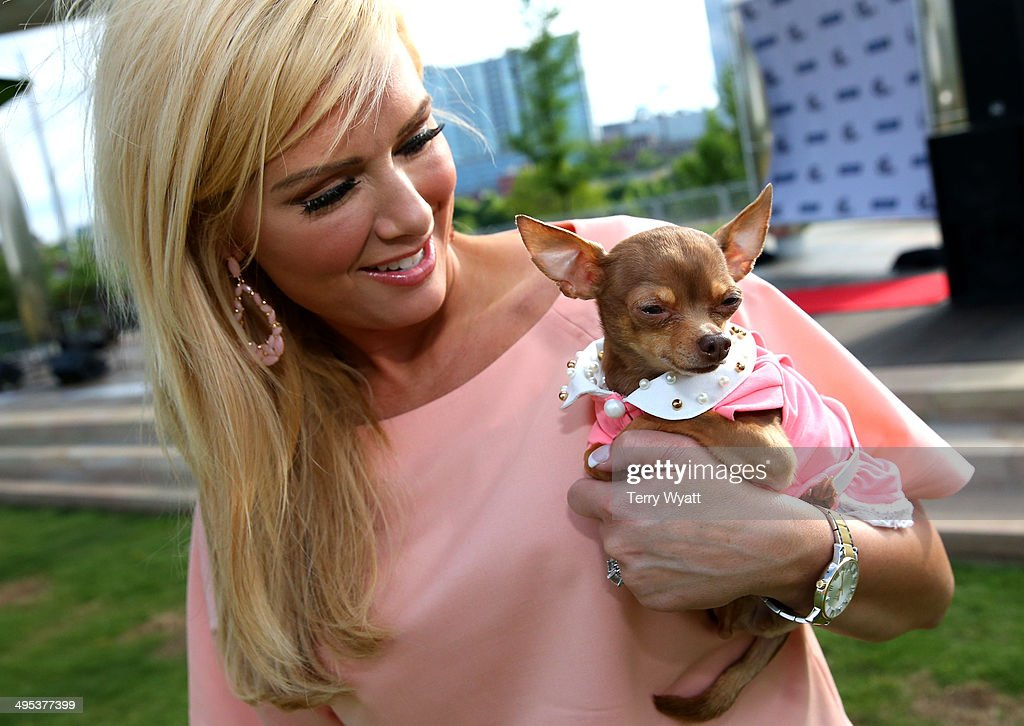 CMT's Allison DeMarcus enjoys the CMT One Country & Dentastix Smile! Party with her pet on June 2, 2014 in Nashville, Tennessee.