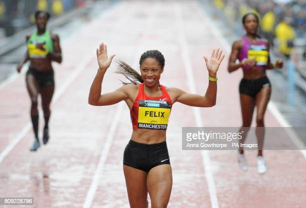 USA's Allyson Felix celebrates winning the Women's 200m Sprint race during the Great City Games Manchester