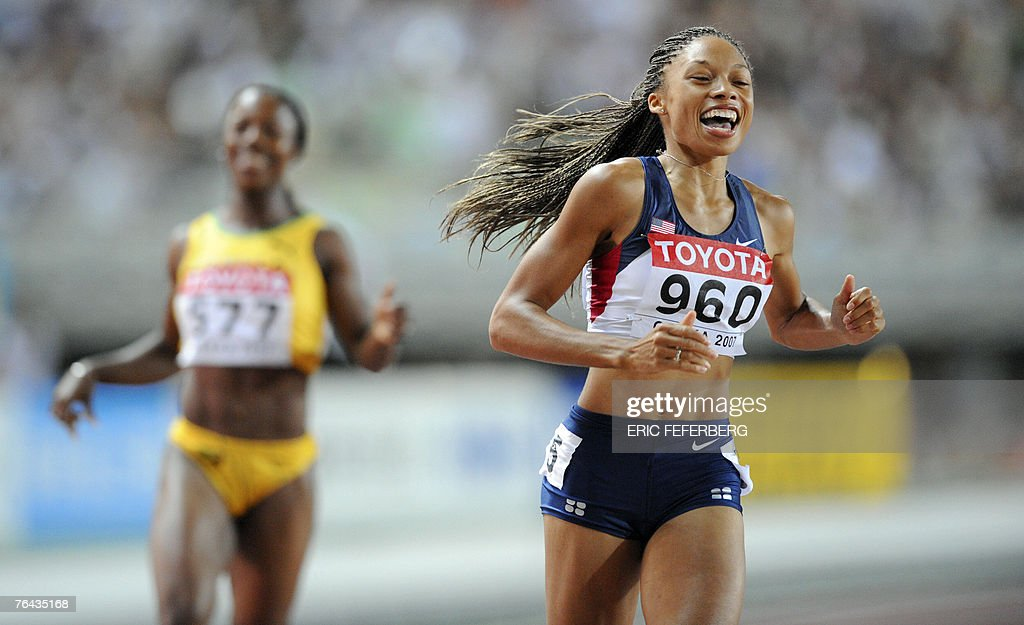 USA's Allyson Felix crosses the finish line during the women's 200m final, 31 August 2007, at the 11th IAAF World Athletics Championships, in Osaka. USA's Allyson Felix won ahead of Veronica Campbell and Sri Lanka's Susanthika Jayasinghe. AFP PHOTO / ERIC FEFERBERG