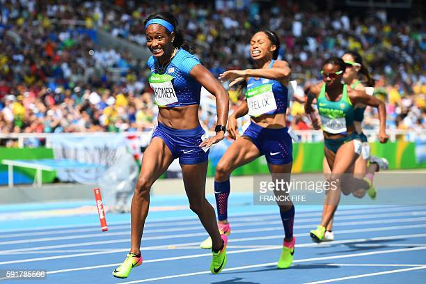 USA's Allyson Felix reacts as she fails to hand the baton to USA's English Gardner in the Women's 4 x 100m Relay Round 1 during the athletics event...
