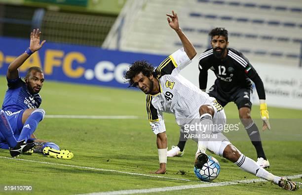 UAE's AlNasr club player Khalifa Mubarak Ghanim and Ahmed Shambih defend as Saudi's AlIttihad club player Abdulrahman AlGhamdi tries to control the...