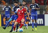 UAE's AlNasr midfielder Tariq Ahmed challenges Iran's Tractorsazi midfielder Soroush Rafiei for the ball during their AFC Champions League round 16...