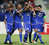 UAE's AlNasr players celebrate after scoring against Iran's Tractorsazi during their AFC Champions League round 16 football match in Dubai on May 17...