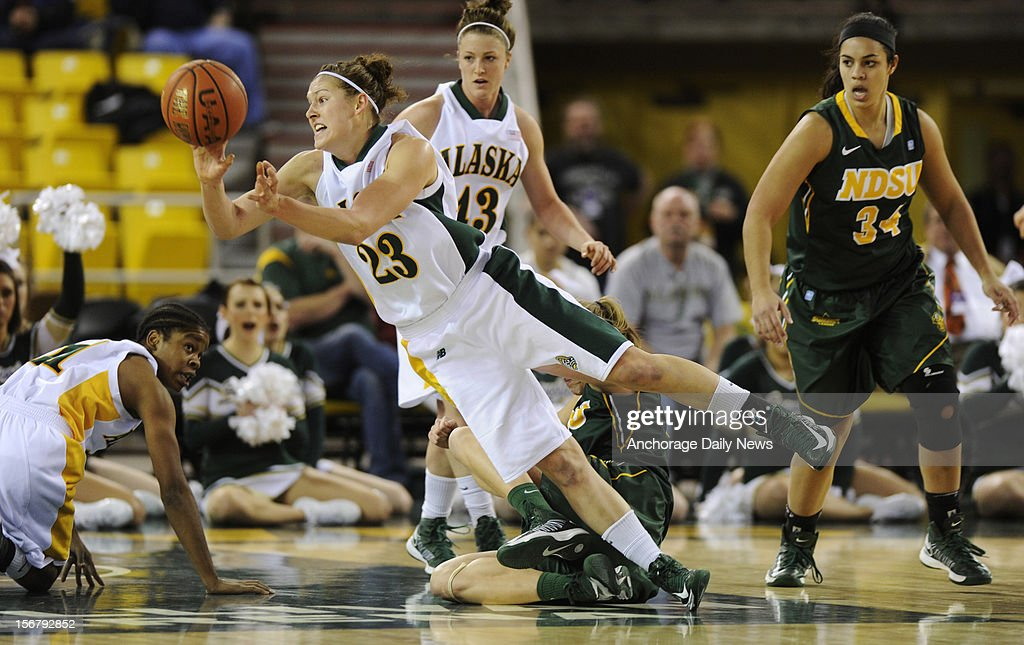 UAA's Alysa Horn gets rid of the ball as she falls to the court. UAA defeated North Dakota State 73-47 in the opening round of the 2012 Women's Great Alaska Shootout tournament on November 20, 2012 in Anchorage, Alaska.