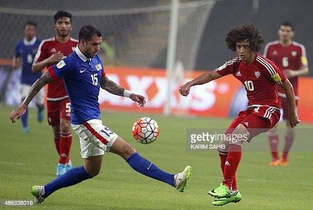 UAE's Amer Abdulrahman fights for the ball with Malaysia's Putera Nadher Amarhan during their AFC qualifying football match for the 2018 FIFA World...