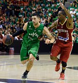 ASVEL's American point guard Trenton Meacham vies with SIG's French small forward Rodrigue Beaubois during the Pro A Basketball game 3 of the final...