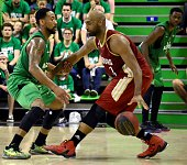 ASVEL's American point small forward David Lighty vies with SIG's American small forward Mardy Collins during the Pro A Basketball game 3 of the...