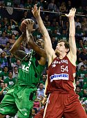 ASVEL's American point small forward David Lighty vies with SIG's American power forward Matt Howard during the Pro A Basketball game 3 of the final...