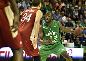 SIG's American power forward Kyle Weems vies with ASVEL's French small forward Charles Kahudi during the Pro A Basketball game 4 of the final match...