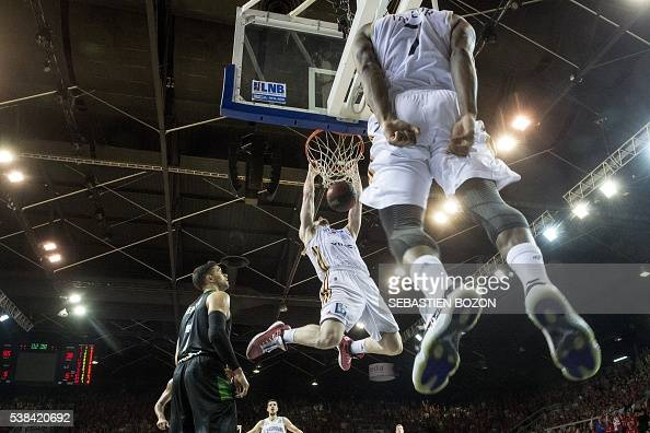 SIG's American power forward Matt Howard smashes the ball during the Pro A Basketball game 2 of the final between Strasbourg and Villeurbanne in...