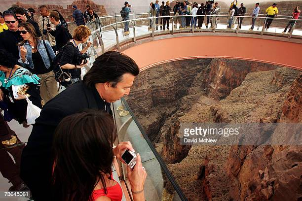 VIP's and members of the media take a preview walk on the Skywalk billed as the firstever cantilevershaped glass walkway extending 70 feet from the...