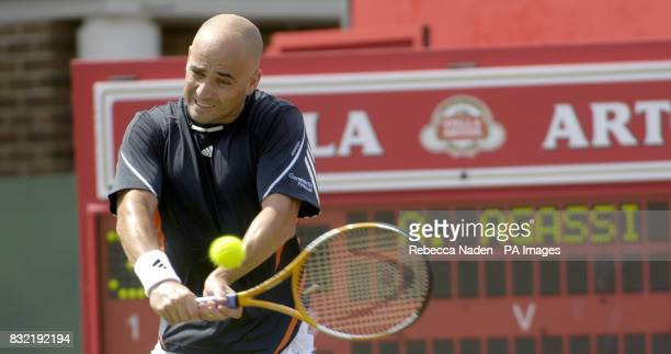 USA's Andre Agassi against Great Britain's Tim Henman during the first round match of The Stella Artois Championships at The Queen's Club London