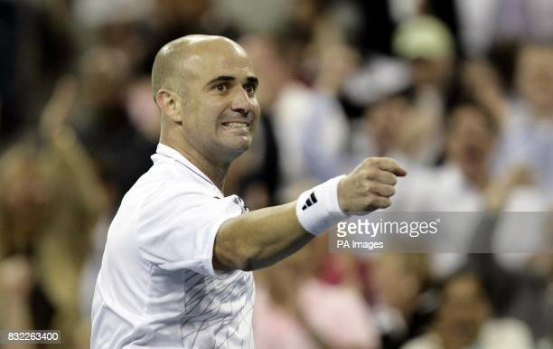 USA's Andre Agassi celebrates after beating Marcos Baghdatis in their second round match at the US Open in Flushing Meadow New York