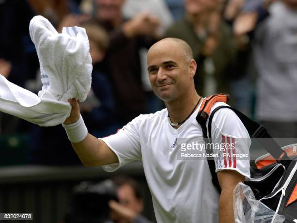 USA's Andre Agassi celebrates his win against Serbia and Montenegro's Boris Pashanski during the first round of The All England Lawn Tennis...