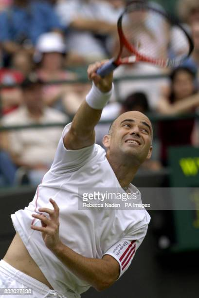 USA's Andre Agassi in action against Italy's Andreas Seppi during the second round of The All England Lawn Tennis Championships at Wimbledon