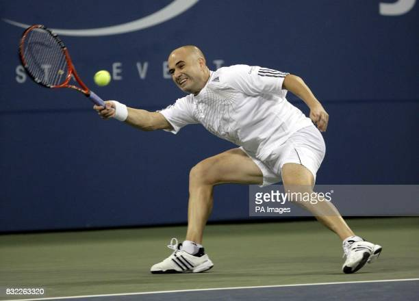 USA's Andre Agassi in action against Marcos Baghdatis during their second round match at the US Open in Flushing Meadow New York