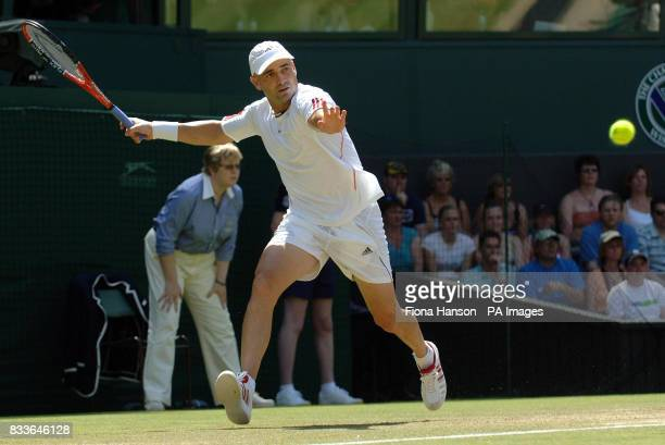 USA's Andre Agassi in action against Spain's Rafael Nadal during the third round of The All England Lawn Tennis Championships at Wimbledon