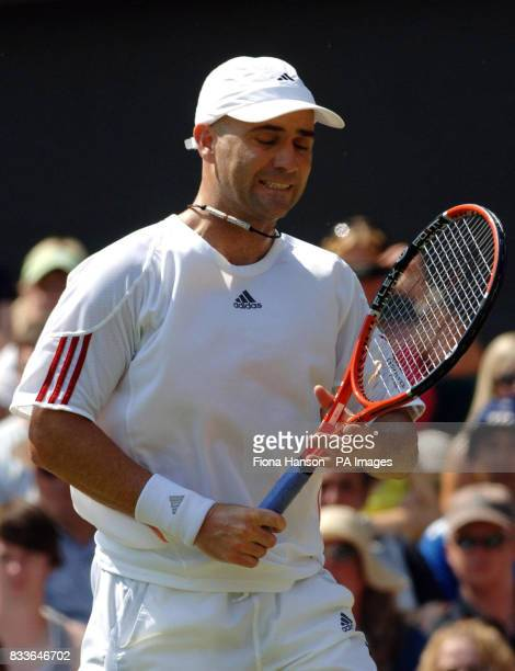 USA's Andre Agassi shows his dejection against Spain's Rafael Nadal during the third round of The All England Lawn Tennis Championships at Wimbledon
