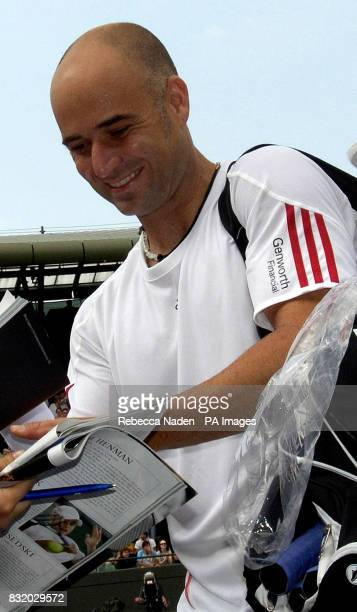 USA's Andre Agassi signs autographs after his win against Italy's Andreas Seppi during the second round of The All England Lawn Tennis Championships...