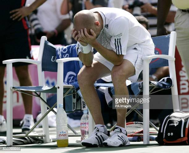 USA's Andre Agassi sits in his chair after losing to Germany's Benjamin Becker in the third round of the US Open at Flushing Meadow New York