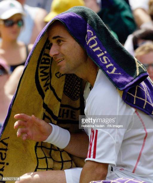 USA's Andre Agassi takes a break during the second round match against Italy's Andreas Seppi at The All England Lawn Tennis Championships at Wimbledon
