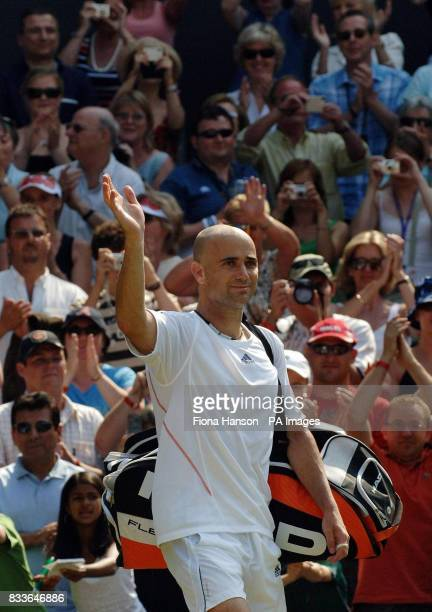 USA's Andre Agassi waves goodbye to the crowd after losing against Spain's Rafael Nadal during the third round of The All England Lawn Tennis...