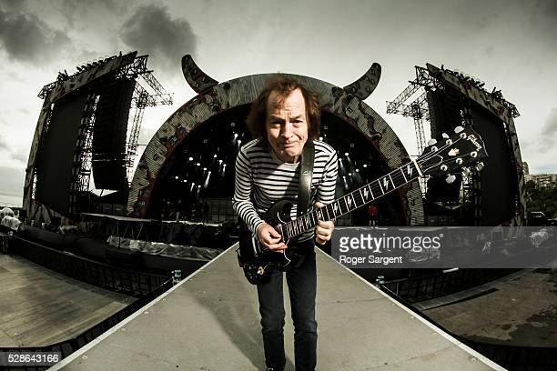 DC's Angus Young poses as he warms up at the soundcheck for the opening night of the Rock Or Bust Tour At the Passeio Maritimo De Alges on May 6 2016...