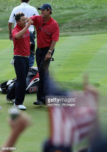 USA's Anthony Kim celebrates victory over Europe's Sergio Garcia with team captain Paul Azinger during Singles on Day Three at Valhalla Golf Club...