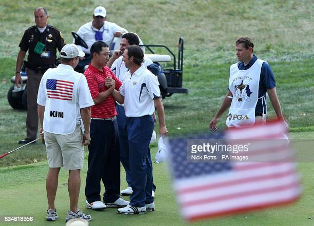 USA's Anthony Kim consoles Europe's Sergio Garcia on the 15th during Singles on Day Three at Valhalla Golf Club Louisville USA