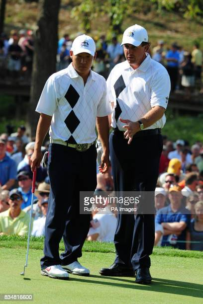 USA's Anthony Kim left and Phil Mickelson discuss their next move on the 14th green during The Foursomes on Day One at Valhalla Golf Club Louisville...