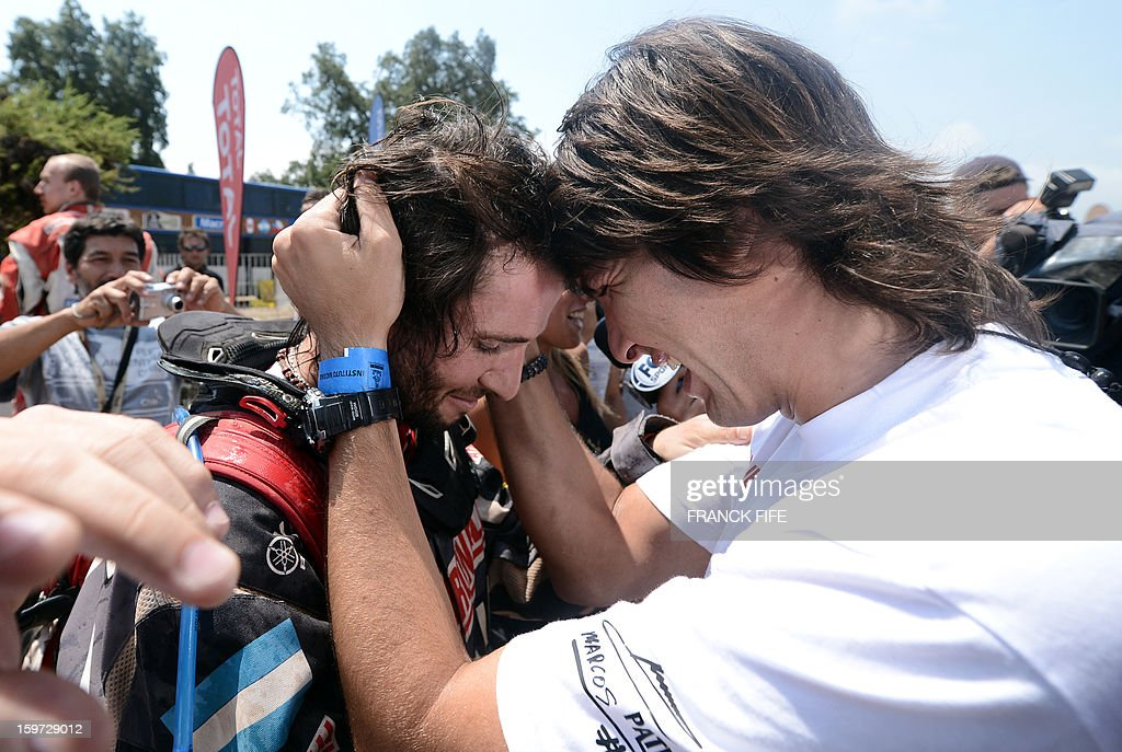 ATV's Argentinian quad driver Marcos Patronelli (L) is congratuled by his brother Alejandro Patronelli after the 14th stage of the Dakar 2013, between La Serena and Santiago, Chile on January 19, 2013. Patronelli finished third in the final stage of the competition. AFP PHOTO / FRANCK FIFE